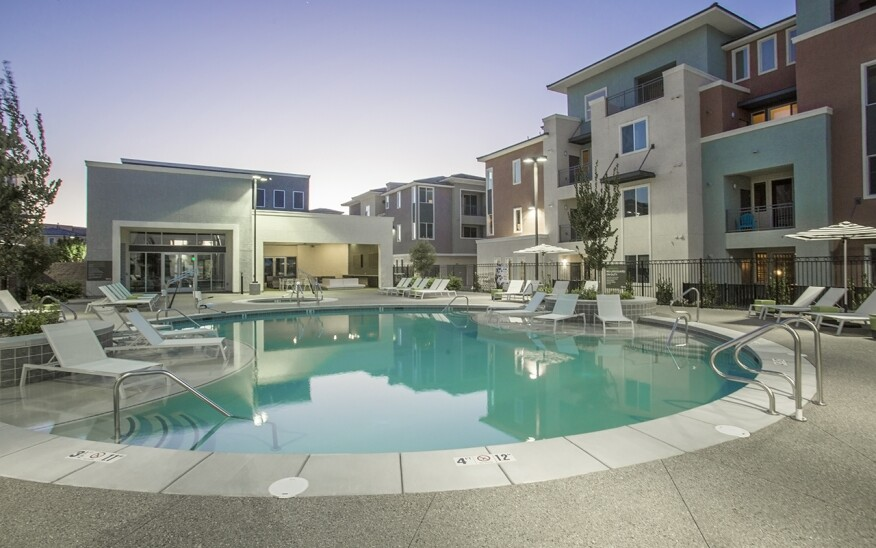 The Calida Group's Elysian at the District property featuring pool deck