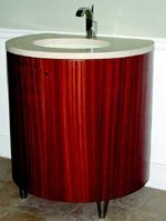 modern vain  Convey a modernist message with the Brava vanity from the Masterpiece Collection. The piece touts clean lines and measures 30 inches wide, 34 inches tall, and 24 inches deep. The marble top can house either a vessel or undermount sink. Select from a range of exotic woods, such as Sapele, Zebrawood, Ash, or Burl. Tapered stainless steel legs complete the sleek look. Vanity Flair, 770.479.0176; www.vanityflair.net.