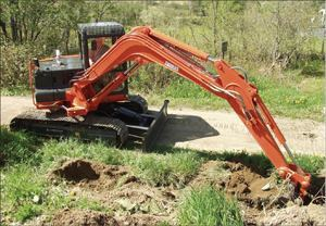 With offset digging, compact excavators are able to keep their tracks parallel to the cut and stay off soft ground.