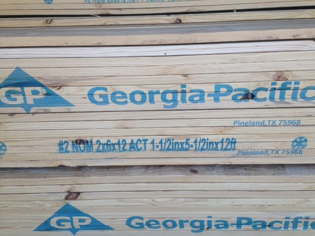 A pallet of lumber from GP shows nominal and actual sizes