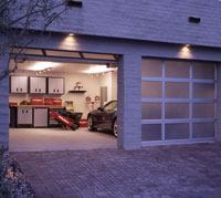 The use of dual garage doors and translucent panels reduces the mass of the two-car garage on the elevation.