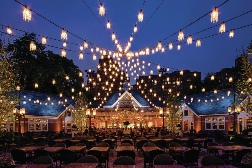 The new courtyard lighting, a series of miniature chandeliers strung to mimic the silhouette of a circus tent's roof, creates a canopy of light against the sky every bit as effective and evocative as the illuminated trees that once were there.