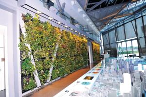 "Elmich green walls utilize a Vertical Greening Module (VGM), which is assembled from high-strength lightweight plastic. Modules are 20"" by 22"" and up to 10"" deep. Each VGM contains a geotextile liner placed in a mostly inorganic planting mix. The living walls reduce sound transmission, enhance air quality, and reduce stormwater runoff. ¢ elmich.com"