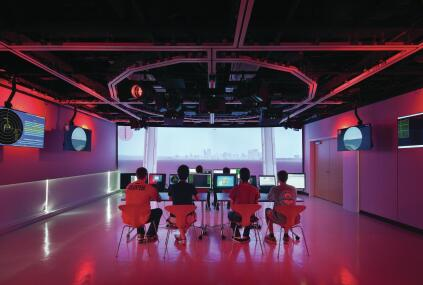 The creativity studio allows students to explore digitally projected environments; a ceiling-mounted system of movable partitions, as well as theatrical lights and projectors, allow for the space to be reconfigured.