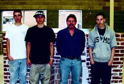Rick Brown's (second from right) masonry students are usually hired before they  complete the whole program.