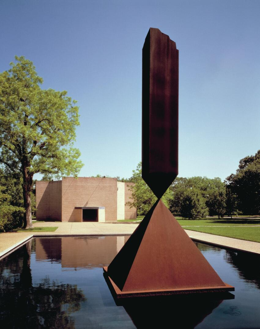 Barnett Newman's Broken Obelisk sculpture, dedicated to Martin Luther King Jr., greets visitors at the Rothko Chapel.