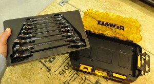 Tools fit into removable internal trays that can be dropped into the drawer of a rolling mechanics tool box.