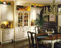 Wellborn Cabinet offers more than 200 door styles and more than 50 finishes. The china cabinet and adjoining pieces shown here are finished with cappuccino with a dark glaze. Bun feet, mullioned doors, corbel accents, and fluted fillers give the cabinetry a formal look.
