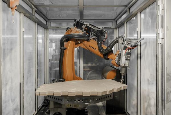 A seven-axis industrial robot was used to fabricate the shell of a pavilion at Stuttgart University due to its flexibility and precision.