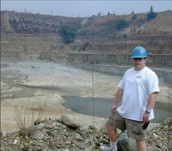 Tim Bubier stands on the edge of Holliday Rock's aggregate pit in Upland, Calif. The  producer of ready-mix, aggregate, and asphalt sells aggregate to other  companies in Southern California.