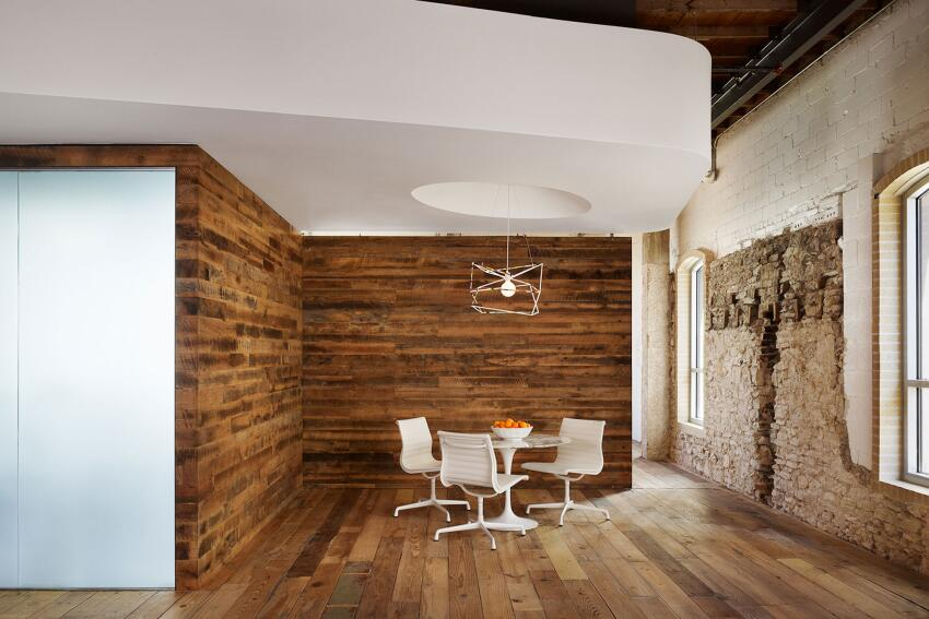 Alterstudio Architects partnered with One.Eleven.Design to create this office space for Peddle, an Internet used-car sales portal based in Austin in the 19th-century Buttrey Building. The clients wanted a space that was fun and creative and would allow for future growth. Custom joist lighting is by Louis Poulsen.