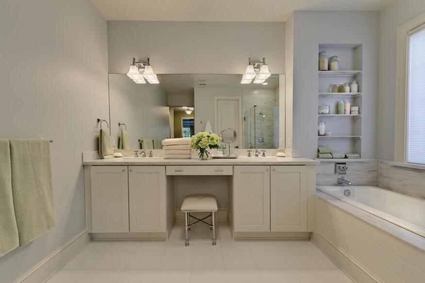 """Clean Dream Light colors can be hard to keep clean, but not in this master bath. """"Large slabs of Corian in the shower stall and tub surround create a streamlined look and are also easier to clean and care for,"""" Martha Stewart explains, because they use less grout. Memoirs bath fixtures by Kohler complement the room's clean lines."""