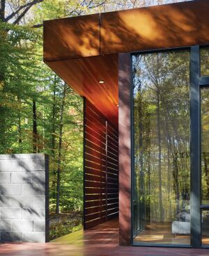 Red Balau boards screen the master suite of this semi-rural home without isolating it from its site. The resulting sheltered deck terminates in an outdoor shower.