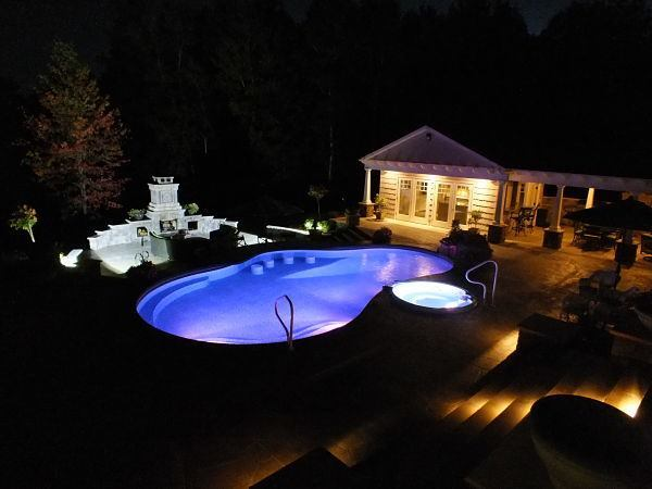 Johnson Pools & Spas of Owego, NY brought a simple L-shaped pool up to date with a free-form vessel featuring luxurious amenities such as bar stools and a radius bench.