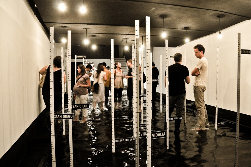 Watermarks, a 2011 exhibition at Woodbury University's WUHO Gallery in Los Angeles, examined rising global water levels through simulation of Venice's Acqua Alta, a biannual flooding of Piazza San Marco.