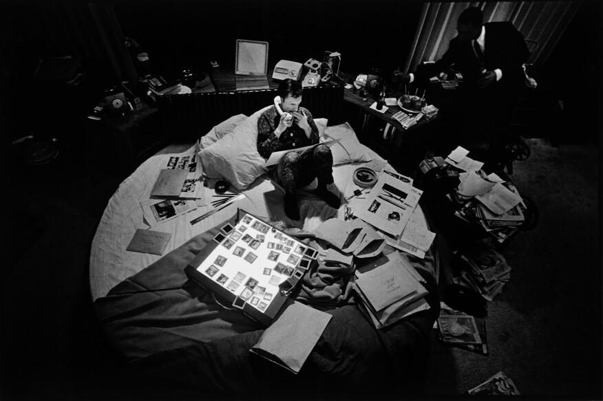 Hugh Hefner in his circular bed, 1966.