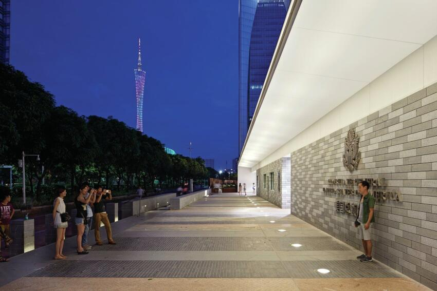 Pathways are lined in a locally quarried stone that also clads the body of the consulate.