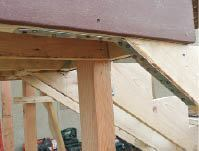 Figure 3. When joists are parallel to the jacks, install blocking between the joists to receive the strapping. The strapping is nailed to the bottom of the outer joist with 16d commons; the combined strength of the inner connections compensates for this somewhat sketchy one