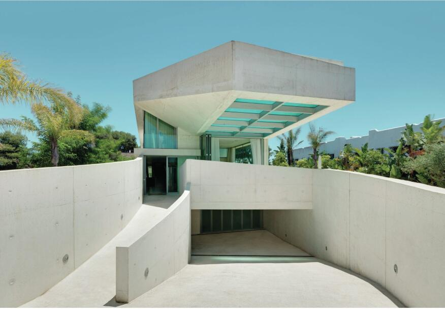 A rooftop pool cantilevers 9 meters (29.5 feet) over the entrance to the Jellyfish House.