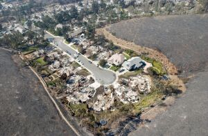 Wildfire entered this neighborhood in the Scripps Ranch area of San Diego and burned multiple houses in fall of 2003. U.S. Navy photo by PH2(AW/SW) Michael J. Pusnik, Jr.
