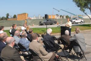 STARTING ANEW. Linda Koelling, mayor of Foster City, Calif., addresses a crowd at the opening of the first stage of redeveopment at that city's Pilgrim/Triton neighborhood.
