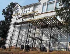 Figure 5. Scaffolding is essential to provide a safe and efficient workplace at a height. Be sure to rent enough to scaffold the sides and the width of the deck, and have extra walk boards to facilitate material handling.