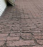 Recently approved legislation that's expected to turn old shingles into 5 to 8 tons of hot-mix asphalt could save Illinois $8 million annually. Photo: Wikimedia Commons