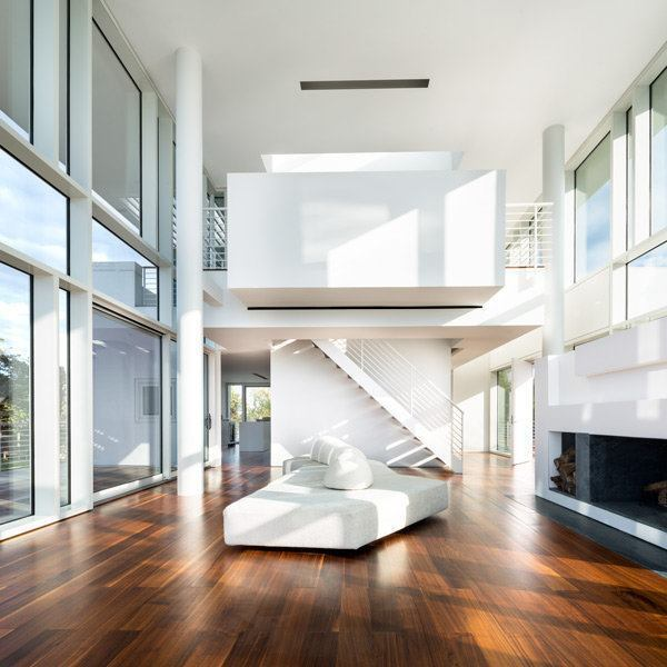 Living room, with a view toward the second level and office loft.