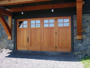 Designed by Chuck Smith, principle of New Design Works, the doors of this winter boat storage in Canandaigua Lake, N.Y., are made of new vertical-grain Douglas fir. The left-hand door opens on a hinge, while the three doors on the right turn, pivot, and slide like a collapsing wall. The difficulty here was controlling gapping due to variations in temperature ó upward of 90∫ F in the summer and -20∫ F and below in the winter. A mahogany stave-core helps control the seasonal movement.