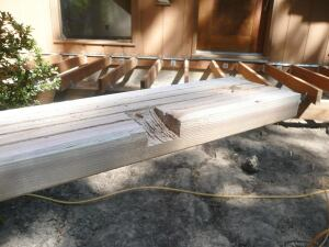 In the bottom of the deck board that's next to the house, and again in the board adjacent to the fascia, the author cuts grooves that will land above each set of joists so that water can drain away.
