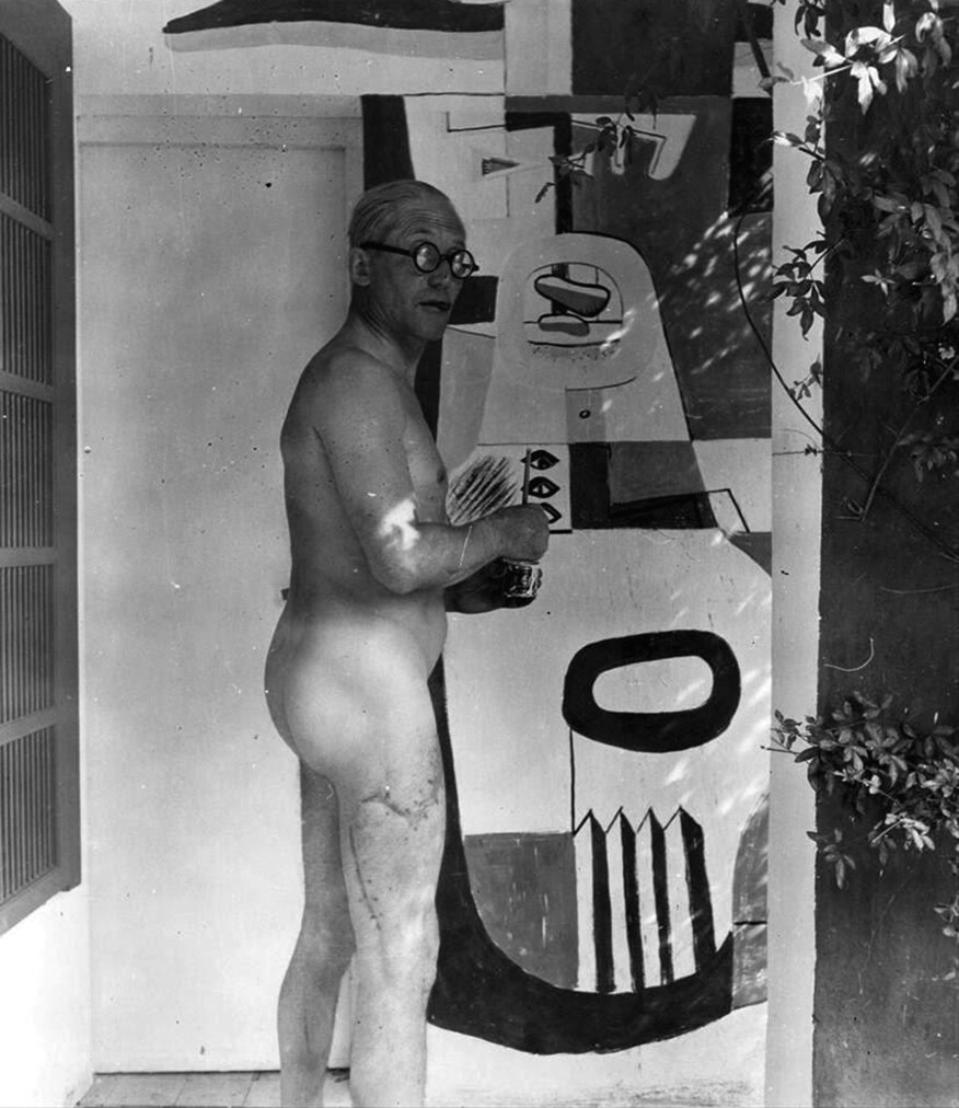 Le Corbusier painting one of his murals at E-1027