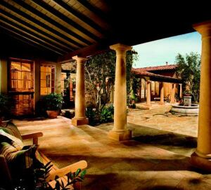 """LIVING ALFRESCO: The 2005 home of the year is an extrovert. Multiple outdoor courts and covered loggias in Plan One of the Baywood Collection at Santaluz serve as """"connective tissue"""" as well as primary living spaces."""