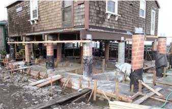 Replacing a beach house foundation jlc online concrete for Concrete pilings for house