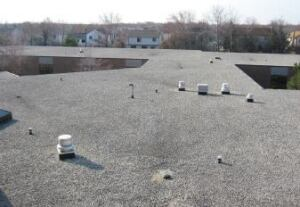 The mass of a ballasted roof system actually acts as a shield protecting a building from solar radiation, which reduces peak temperatures.
