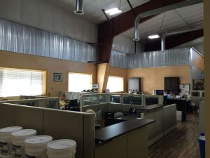 The new offices at Howe Lumber feature more open work spaces instead of cubicles in an effort to create more collaboration among the team and break down silos.