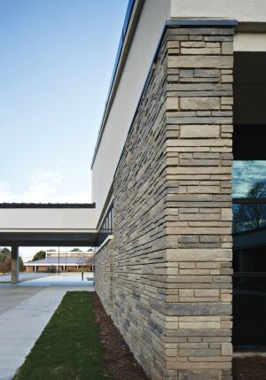 Oldcastle APG has invested in masonry education as well as their Echelon Masonry brand, which includes manufactured stone veneers, such as Lamins Stone shown here, high-performance wall systems, and bagged goods.
