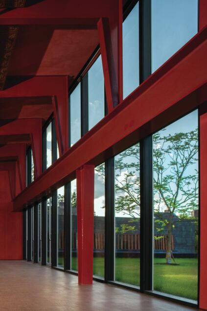 The multipurpose performance space in the western portion of the building seats up to 200. Its exposed steel beams are coated in a crimson red Sherwin Williams paint.