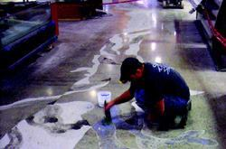 The river art is flush with the surrounding polished gray concrete for a floor that is both safe and fascinating for shoppers of all ages.
