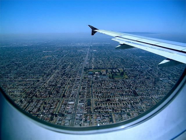An aerial view of Los Angeles shows sprawl that extends beyond the range of visibility.