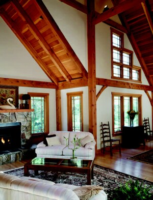 At this home in Lakeville, Mass., designer Steve Petty of Davis Frame Co. used Douglas fir timbers with matching interior trim, and an open floor plan with cathedral ceilings in this Arts and Crafts-style home. The timber frames were pre-cut, dry fitted, and numbered in the factory, then packed with the structural insulated panels, which were cut on site.