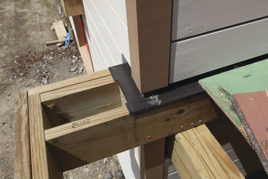 At the deck ledger at the bottom of the wall, flashing channels away any water from the drainage plane of the wall.
