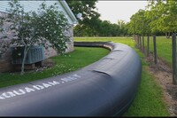 """Fight Water With Water: """"AquaDam"""" Saves Texas Home From Flood"""