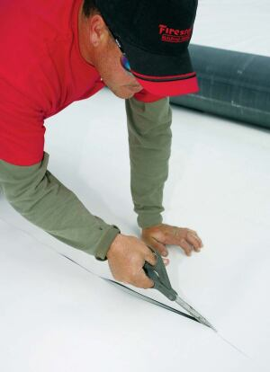 """Firestone's lastest EPDM rubber membrane, RubberGard EcoWhite, adds 60-mils of membrane to the roof with a simple roll installation. It has a solar reflectance of .80 and a solar reflectance index of 99, when tested in compliance with the Cool Roof Rating Council.    10', 16'-8"""", 20', or 25' widths  www.firestonebpco.com"""