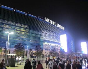 The Solar Ring at MetLife Stadium uses Building Integrated Photovoltaic Panels to create a programmable color ring encircling the top of the stadium. The BIPVs will be illuminated with LED lighting to display the signature blue and green colors of the NFL's New York Giants and New York Jets.