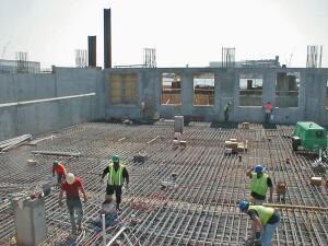 Here note the lack of special rebar placement, joint doweling, or joint detail construction. Savings on these special construction items, along with the time savings of a monolithic placement, helped to bring this stage of the project in on time and below budget.