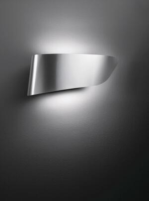 Eurialois a wall lamp by Artemide made from molded aluminum. Designed by Pio and Tito Toso, the luminaire provides both indirect and direct lighting. Halogen and fluorescent lamps can be used with the fixture, which is available in two finishes: aluminum and polished white.  artemide.com