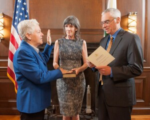 EPA Deputy Administrator Bob Perciasepe swears in Gina McCarthy (left) as the agency's new leader with former EPA Administrator Carol Browner.