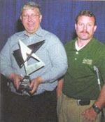 Thomas Pritchard (left) and Frankie Johnson of Jones-Onslow EMC accept their company's 2005 Geospatial Information & Technology Association Innovator Award. Photo: GITA