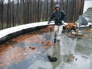 The small, 5-inch-by-5-inch scuppers in the parapet wall were inadequate to the task of draining this poorly sloped roof.