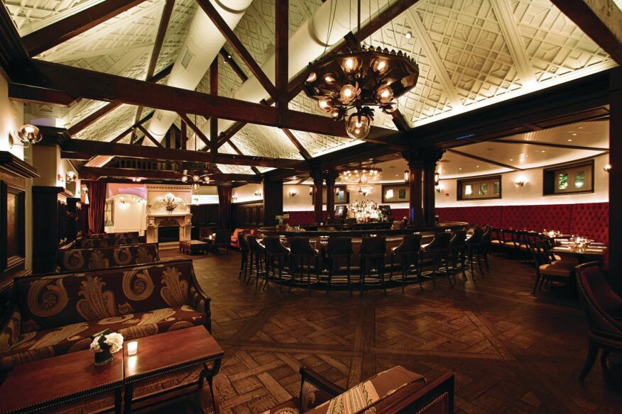In the bar area, as well as throughout the restaurant, LED low-voltage uplights are hidden on top of the beams to provide ambient light and to highlight the architectural detail work on the ceiling.